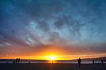 People on the beachat sunset in Santa Monica, CA