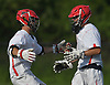 Kyle Bockelman #1, Hills East goalie, right, gets congratulated by teammate Noah Dooley #18 after the Thunderbirds' 11-9 win over Commack in the Suffolk County varsity boys lacrosse Division I (Class A) quarterfinals at Half Hollow Hills High School East on Friday, May 19, 2017. Bockelman made 17 saves in Hills East's victory.