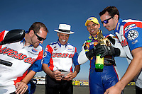 Jul. 28, 2013; Sonoma, CA, USA: NHRA pro stock motorcycle rider Hector Arana Jr (center) celebrates with father Hector Arana Sr (left) Adam Arana and crew after winning the Sonoma Nationals at Sonoma Raceway. Mandatory Credit: Mark J. Rebilas-