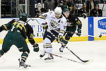 SIOUX FALLS, SD - DECEMBER 7:  C.J. Franklin #15 from the Sioux Falls Stampede controls the puck between Joe Snively #15 and Cedric Lacroix #14 from the Sioux City Musketeers in the first period of their game Saturday night at the Sioux Falls Arena. (Photo by Dave Eggen/Inertia)