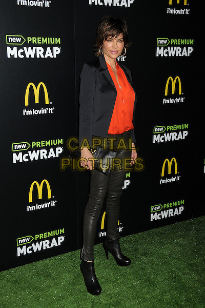 Lisa Rinna.McDonald's Premium McWrap Launch Party held at Paramount Studios, Los Angeles, California, USA..March 28th, 2013.full length black blazer orange red shirt leather trousers  .CAP/ADM/BP.©Byron Purvis/AdMedia/Capital Pictures.