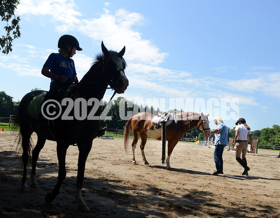 "Patricia ""Penny"" Silcox (center) works with horse riding students at Blue Jacket Farm Saturday August 13, 2016 in New Hope, Pennsylvania. Her business partners, Michael and Michelle Gara, allege she reneged on a verbal deal to give them control of Hickory Run Farms after they invested more than $1 million in the operations. (Photo by William Thomas Cain)"