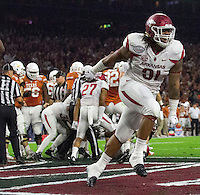 Arkansas Democrat-Gazette/BENJAMIN KRAIN --12/29/14--<br /> Arkansas's Darius Philon celebrates after the Razorbacks recovered a fumble in the endzone by Texas quarterback Tyrone Swoopes for a touchdown during the 2nd quarter in the Texas Bowl Monday night at NRG Stadium in Houston.