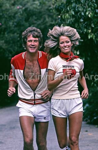 Farrah Fawcett and husband Lee Majors jogging near their home in Los Angeles, California, 1977. Photo by John G. Zimmerman.