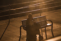 woman waiting for train at dusk