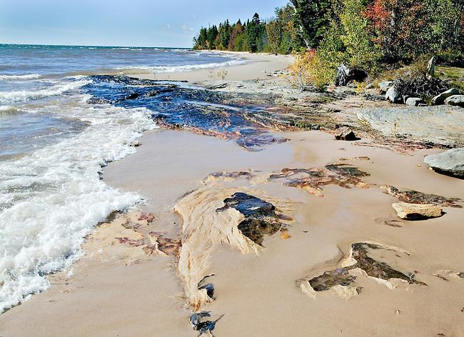 breaking waves on on beach in autumn, Lake Superior, MI.