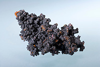 TENORITE ON COPPER<br /> (Variations Available).<br /> Copper Oxide (CuO), A Secondary Copper Mineral<br /> Thin coating of Tenorite on micro Cuprite octahedrons on native Copper. Also known  as black copper oxide, melanconite and melanochalcite. Monoclinic, prismatic crystal.