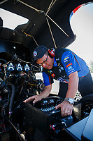 Mar 18, 2017; Gainesville , FL, USA; Crew chief Jimmy Prock makes an adjustment to the car of NHRA funny car driver Robert Hight during qualifying for the Gatornationals at Gainesville Raceway. Mandatory Credit: Mark J. Rebilas-USA TODAY Sports