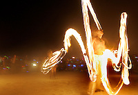 BLACK ROCK CITY,NV - AUGUST 30, 2008: Firedancers during closing ceremony and finale of the Burning Man event, August 30, 2008. The annual arts festival attracts over 30,000 participants to the Nevada desert each year.