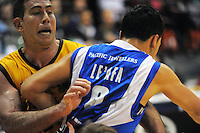 Aaron Bailey-Nowell tussles with Izayah Mauriohooho-Le'afa during the national basketball league match between Wellington Saints and Taranaki Mountainairs at TSB Bank Arena, Wellington, New Zealand on Friday, 17 June 2014. Photo: Dave Lintott / lintottphoto.co.nz