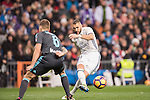 Karim Benzema of Real Madrid shoots past Inigo Martinez Berridi of Real Sociedad during their La Liga match between Real Madrid and Real Sociedad at the Santiago Bernabeu Stadium on 29 January 2017 in Madrid, Spain. Photo by Diego Gonzalez Souto / Power Sport Images