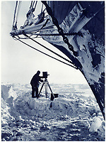BNPS.co.uk (01202 558833)<br /> Pic: Bonhams/BNPS<br /> <br /> Hurley at work with his camera - tragically he could only carry 120 of the 400 glass plates he had taken with him when the Endurance was crushed.<br /> <br /> Photographic record of one of the worlds most epic tales of endurance...<br /> <br /> Remarkable photos documenting Sir Ernest Shackleton's ill-fated attempt to cross Antarctica over 100 years ago have emerged for sale for £40,000.<br /> <br /> The 1914-17 expedition is remembered for one of the greatest feats of human bravery and endurance after the party became stranded for 18 months in freezing conditions. <br /> <br /> The expedition's official photographer, Frank Hurley, captured their ordeal on camera and made presentation albums when he eventually returned to Britain.<br /> <br /> One album was given to King George V. Seven are believed to survive today, including the one for sale that has been owned by a private collector for over 40 years.
