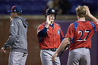 Cody Kramer (3) of the NJIT Highlanders is greeted by teammate Tommy Derer (27) after scoring a run during the game against the High Point Panthers at Williard Stadium on February 18, 2017 in High Point, North Carolina. The Highlanders defeated the Panthers 4-2 in game two of a double-header. (Brian Westerholt/Four Seam Images)