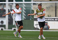 Thomas Muller and Bastian Schweinsteiger of Germany during training ahead of tomorrow's World Cup Final