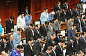 Mar. 17, 2011 - Tokyo, Japan - Japanese Prime Minister Naoto Kan leads a silent prayer to the victims of The 2011 Tohoku earthquake and tsunami at the start of The House of Representatives Plenary session. (The third person from the end left of row). (Photo by Taro Fujii)..