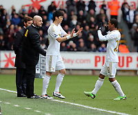 Pictured: Jonathan de Guzman (R) of Swansea is substituted by Ki Sung Yueng. Saturday 30 March 2013<br /> Re: Barclay's Premier League, Swansea City FC v Tottenham Hotspur at the Liberty Stadium, south Wales.
