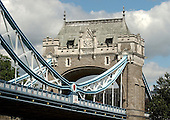 London, GBR - August 7, 2005 -- Detail of one of the structures on the shoreline of the Tower Bridge, showing an archway and the roadway that goes through it, taken from a ferry in the Thames River on August 7, 2005.  The Tower Bridge, one of the most recognizable landmarks in London, is sometimes mistaken for London Bridge..Credit: Ron Sachs / CNP