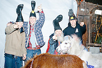 From left, Damian Thorne, Nick Belisle, and Alan Clement, all of Rochester, NH, pose for pictures with satirical presidential candidate Vermin Supreme and two patriotic-themed ponies before a stump speech at Ten Rod Farm in Rochester, New Hampshire. The three said they are supporters of Vermin Supreme. Supreme's platform advocates a pony-based economy, using zombies to solve the energy crisis, and other outlandish ideas. Supreme has been on the New Hampshire primary ballot in 2008 and 2012, though he began running for president in 1992. Vermin Supreme will be on the Democratic party ballot in the 2016 New Hampshire primary.