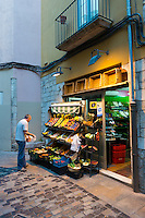 Fruit stalls on old street in Girona, Spain, Europe