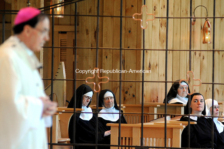 BETHLEHEM  CT, 13 MAY 2012-051312JS03-SIsters at the Abbey of Regina Laudis look as as The Most Reverend Henry J. Mansell, D.D., .Fourth Archbishop of Hartford  speaks during Mass celebrating  50 years of vowed life of Rt. Rev. Mother David Seerna, O.S.B, Abbess of the Abbey of Regina Laudis, Sunday at the Church of Jesu Fili Mariæ at the Abbey in Bethlehem. .Jim Shannon Republican-American