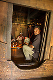 INDONESIA, Flores, Ngada District, a man prepares to sacrifice a chicken in a home at Belaraghi village