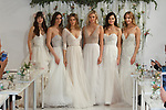 Models pose in gowns for the Watters Fall 2017 fashion show at The Knot COUTURE Show on April 23, 2017, during New York Bridal Fashion Week.