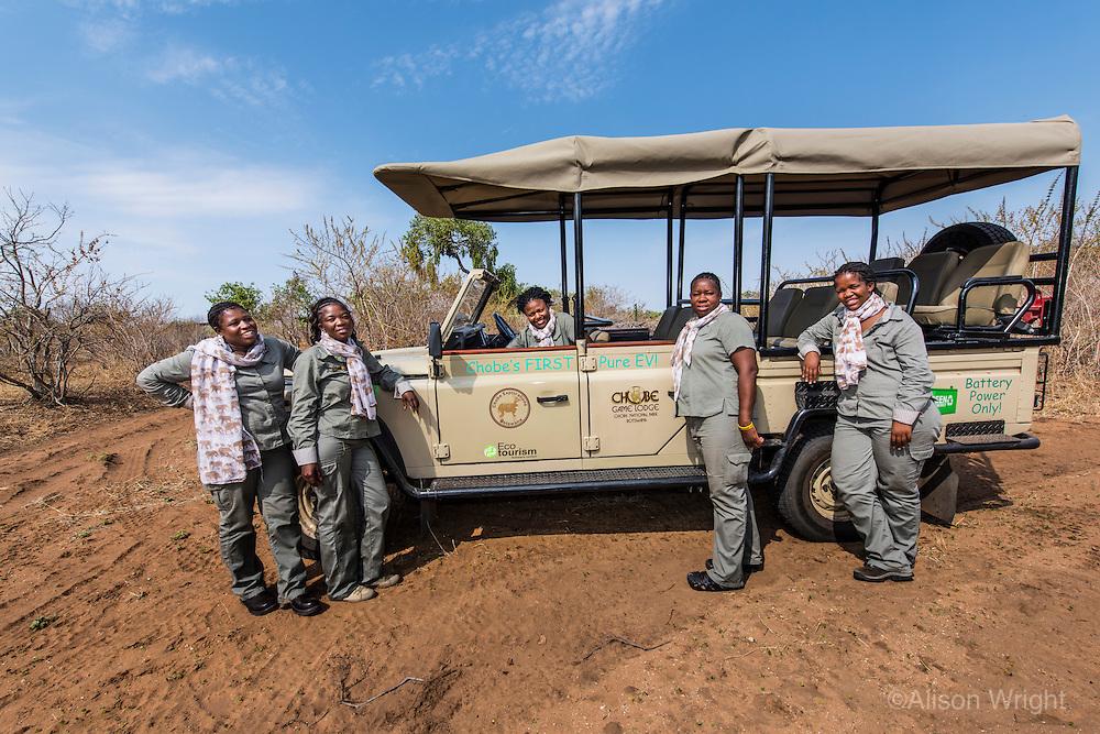 "Africa, Botswana, Kasane, Chobe Game Lodge. Chobe National Park. All women guides, ""Chobe's Angels,"" in the bush with their vehicle. Neo Moatshe, Malebogo Lebo Kgoleng, Oratile Beula, Yazema Connie Bbaena, Saokfufa Sedisa."