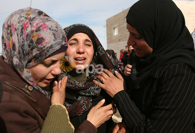 Palestinian women mourn during the funeral of two boys who were killed the previous day when unexploded military ordinance detonated outside Hebron, during their funeral in Wadi al-Rim, West Bank, 07 March 2012. Palestinian police announced on 06 March that two 12-year-old Palestinian boys, Hamza Jaradat and Zayed Jaradat, were killed, and three others injured, when unexploded ordinance exploded.  Photo by Ismail Youssef