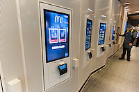 Digital ordering kiosks in a prototype McDonald's in New York, upscaling with minimalist decor, a greeter, and a McCafe, on Wednesday, February 1, 2017.  (© Richard B. Levine)