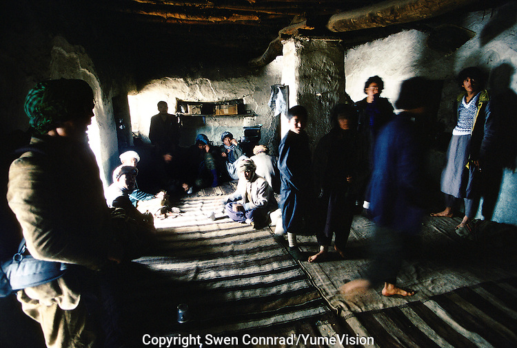 Ferrymans and Mujahedins resting in a tea house after passing the Wonay Pass at 3352 meters high on the way to Bamiyan charge with food. Hazarajat, Afghanistan.