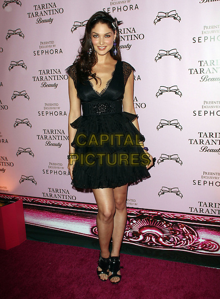 "BLANCA SOTO .Attending the Launch of The ""Tarina Tarantino Beauty"" Cosmetic Collection presented Exclusively at Sephora,.Hollywood, California, USA,.24th February 2010..full length black dress lace ruffles ruffle tiered open toe sandals .CAP/ADM/KB.©Kevan Brooks/AdMedia/Capital Pictures."
