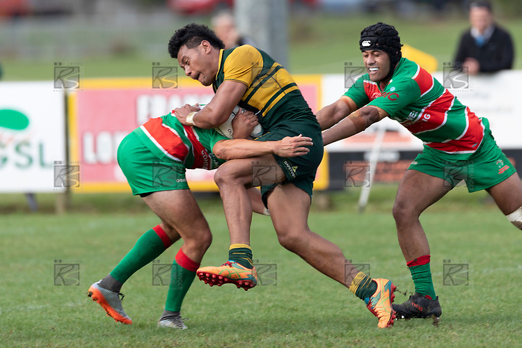 Sione Fifita charges in to Christian Walker's tackle. Counties Manukau Premier Club rugby game between Pukekohe and Waiuku, played at Colin Lawrie Fields, Pukekohe on Saturday April 14th, 2018. Pukekohe won the game 35 - 19 after leading 9 - 7 at halftime.<br /> Pukekohe Mitre 10 Mega -Joshua Baverstock, Sione Fifita 3 tries, Cody White 3 conversions, Cody White 3 penalties.<br /> Waiuku Brian James Contracting - Lemeki Tulele, Nathan Millar, Tevta Halafihi tries,  Christian Walker 2 conversions.<br /> Photo by Richard Spranger