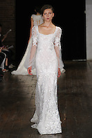 """Model walks runway in a """"Delight"""" bridal gown from the Alyne by Rita Vinieris Fall 2017 collection on October 7th, 2016 during New York Bridal Fashion Week."""