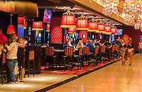 Las Vegas, Nevada.  The Linq Casino.  People Relaxing over Drinks.