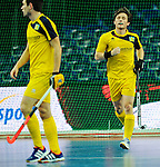 Leipzig, Germany, February 08: (r) Karl Hemvik #2 of Sweden looks on during the placement match (5th / 6th) between Sweden (yellow) and Russia (red) on February 8, 2015 at the FIH Indoor Hockey World Cup at Arena Leipzig in Leipzig, Germany. Final score 1-3 (1-0). (Photo by Dirk Markgraf / www.265-images.com) *** Local caption ***