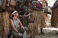 Indigenous boy and caucasian man at the Laura Aboriginal Dance Festival.  Laura, Queensland, Australia
