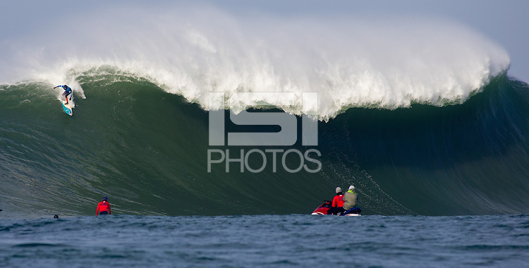 Half Moon Bay, California - January 24, 2014: 2014 Maverick's Invitational Peter Mel dropping in.
