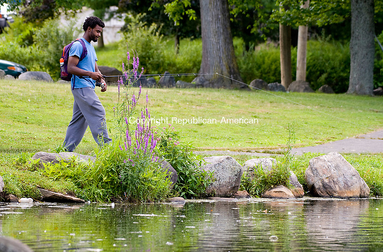 WATERBURY, CT-0713017JS02-- Dayshawn Smith of Waterbury enjoys an afternoon fishing at one of the ponds at Fulton Park in Waterbury on Sunday. <br /> Jim Shannon Republican-American