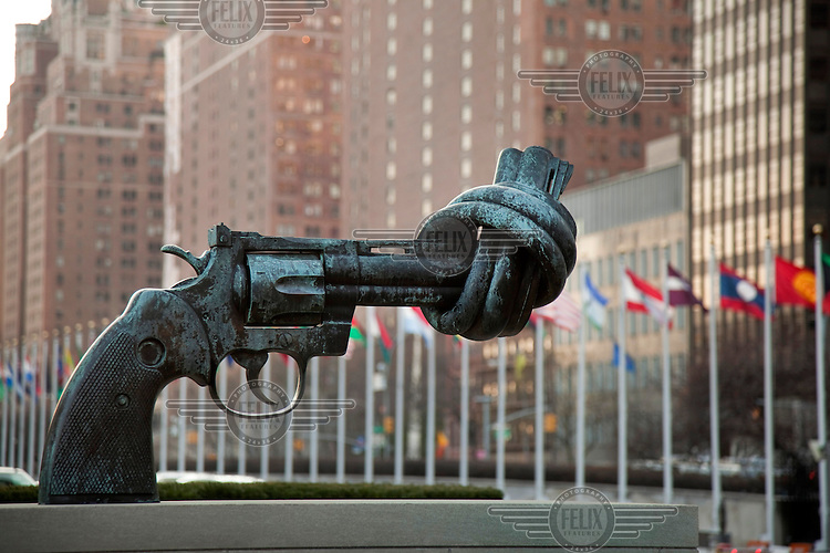 A sculpture by Carl Fredrik Reutersward outside the United Nations building in Manhattan in the shape of a gun with its barrel made into a knot.