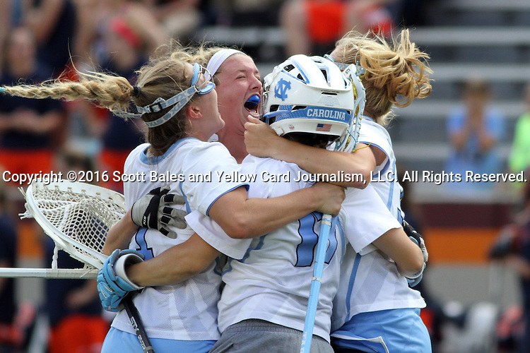 01 May 2016: North Carolina's Megan Ward (17) is mobbed by teammates at the end of the game. The University of North Carolina Tar Heels played the Syracuse University Orange at Lane Stadium in Blacksburg, Virginia in the 2016 Atlantic Coast Conference Women's Lacrosse Tournament championship match. North Carolina won 15-14 in overtime.