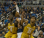 California Baptist forward  Bul Kuol (11) and forward De'jon Davis (35) box out Nevada's Jordan Brown (21) in the second half of an NCAA college basketball game in Reno, Nev., Monday, Nov. 19, 2018. (AP Photo/Tom R. Smedes)