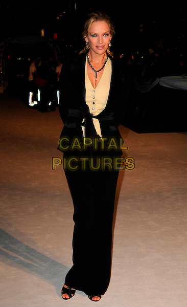 "UMA THURMAN.""The Accidental Husband"" UK film premiere, Vue West End, London, England..February 13th 2008.full length black suit jacket trousers yellow cardigan.CAP/CAN.©Can Nguyen/Capital Pictures."