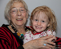 Happy young great granddaughter in the arms of her Polish great grandmother age 4 and 86. Zawady Central Poland