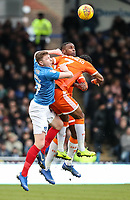 Blackpool's Donervon Daniels (centre) competing with Portsmouth's Dion Donohue (left) <br /> <br /> Photographer Andrew Kearns/CameraSport<br /> <br /> The EFL Sky Bet League One - Portsmouth v Blackpool - Saturday 12th January 2019 - Fratton Park - Portsmouth<br /> <br /> World Copyright &copy; 2019 CameraSport. All rights reserved. 43 Linden Ave. Countesthorpe. Leicester. England. LE8 5PG - Tel: +44 (0) 116 277 4147 - admin@camerasport.com - www.camerasport.com