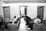 BEACON, NEW YORK: Prisoners watch tv during a lunch break at the residential unit they share with the dogs in the Puppies Behind Bars program at Fishkill Correctional Facility. The program works with prison inmates in New York, New Jersey, and Connecticut to train service dogs, including ones who help injured soldiers or those suffering from post-traumatic stress. The puppies live with the prisoners during a 18-24-month training process.