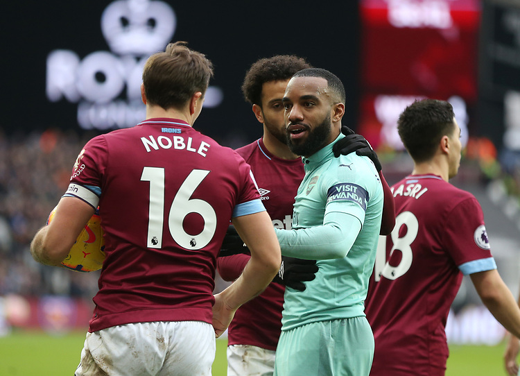 West Ham United's Mark Noble and Arsenal's Alexandre Lacazette have a disagreement<br /> <br /> Photographer Rob Newell/CameraSport<br /> <br /> The Premier League - West Ham United v Arsenal - Saturday 12th January 2019 - London Stadium - London<br /> <br /> World Copyright © 2019 CameraSport. All rights reserved. 43 Linden Ave. Countesthorpe. Leicester. England. LE8 5PG - Tel: +44 (0) 116 277 4147 - admin@camerasport.com - www.camerasport.com