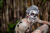A young Salvadoran man with skull face paint performs during the La Calabiuza parade at the Day of the Dead celebration in Tonacatepeque, El Salvador, 1 November 2016. The festival, known as La Calabiuza since the 90s of the last century, joins Salvador's pre-Hispanic heritage and the mythological figures (La Sihuanaba, El Cipitío, La Llorona etc.) collected from the whole Central American region, together with the catholic All Saints Day holiday and its tradition of honoring the dead relatives. Children and youths only, dressed up in scary costumes and carrying painted carts, march from the local cemetery to the downtown plaza where the party culminates with music, dance, drinking and eating pumpkin (Ayote) with honey.