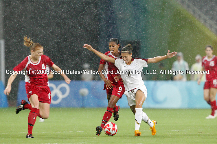 15 August 2008: Candace Chapman (CAN) (9) challenges Carli Lloyd (USA) (11) for the ball.  The women's Olympic team of the United States defeated the women's Olympic soccer team of Canada 2-1 after extra time at Shanghai Stadium in Shanghai, China in a Quarterfinal match in the Women's Olympic Football competition.