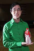 New York, NY, USA - June 26, 2011: Brian Chan, Origami designer and folder at the OrigamiUSA Convention in New York City, holding his creation a samurai warrior with sword.