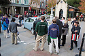 Crowd gathering to check out the electric car on display. Nissan Leaf Zero Emission Tour promotional event for the Nissan Leaf electric car that is scheduled to be released in Fall 2010. Car specs from Nissan: 5 person capacity, 90 MPH top speed, lithium-ion battery, 100 mile average range per charge. Santana Row, San Jose, California, USA, 12/5/09